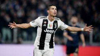 Juventus' Portuguese forward Cristiano Ronaldo celebrates after opening the scoring during the UEFA Champions League group H football match Juventus vs Manchester United at the Allianz stadium in Turin on November 7, 2018. (Photo by Marco BERTORELLO / AFP)