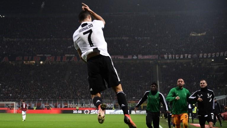 Juventus' Portuguese forward Cristiano Ronaldo celebrates after scoring during the Italian Serie A football match AC Milan vs Juventus on November 11, 2018 at the San Siro stadium in Milan. (Photo by Marco BERTORELLO / AFP)
