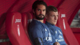 Real Madrid's midfielder Isco (L) and Real Madrid's German midfielder Toni Kroos sit on the bench before the Spanish league football match Granada FC vs Real Madrid CF at Nuevo Los Carmenes stadium in Granada on May 6, 2017. (Photo by SERGIO CAMACHO / AFP)