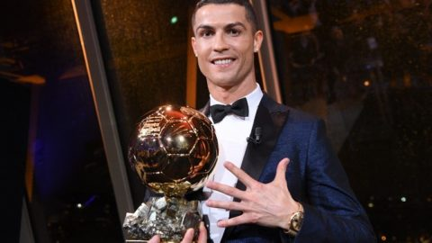 """This handout photo released on December 8, 2017 by L'Equipe shows Portugese player Cristiano Ronaldo posing with the 2017 Ballon d'Or France Football trophy in Paris on December 7, 2017. - Portuguese star Cristiano Ronaldo won a record-equalling fifth Ballon d'Or (2008, 2013, 2015, 2016 and 2017) award for the year's best player on December 7. The Real Madrid forward's second successive win draws him level alongside Barcelona rival Lionel Messi on five Ballon d'Ors, after beating the Argentinian and Brazilian Neymar. (Photo by Franck FAUGERE / L'EQUIPE / AFP) / RESTRICTED TO EDITORIAL USE - MANDATORY CREDIT """"AFP PHOTO / L'EQUIPE / FRANCK FAUGERE"""" - NO MARKETING NO ADVERTISING CAMPAIGNS - DISTRIBUTED AS A SERVICE TO CLIENTS"""
