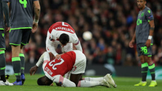LONDON, ENGLAND - NOVEMBER 08: Henrikh Mkhitaryan of Arsenal stands over Danny Welbeck of Arsenal as he is injured  during the UEFA Europa League Group E match between Arsenal and Sporting Lisbon at Emirates Stadium on November 08, 2018 in London, United Kingdom. (Photo by Richard Heathcote/Getty Images)