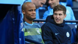 Manchester City's Belgian defender Vincent Kompany (L) looks on from the sidelines during the English Premier League football match between Manchester City and Brighton and Hove Albion at the Etihad Stadium in Manchester, north west England, on September 29, 2018. (Photo by Lindsey PARNABY / AFP) / RESTRICTED TO EDITORIAL USE. No use with unauthorized audio, video, data, fixture lists, club/league logos or 'live' services. Online in-match use limited to 120 images. An additional 40 images may be used in extra time. No video emulation. Social media in-match use limited to 120 images. An additional 40 images may be used in extra time. No use in betting publications, games or single club/league/player publications. /
