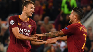 AS Rome's Bosnian forward Edin Dzeko (L) celebrates with AS Rome's Italian midfielder Lorenzo Pellegrini after scoring his second goal during the UEFA Champions League group G football match between AS Roma and FC Viktoria Plzen on October 2, 2018 at the Olympic stadium in Rome. (Photo by Andreas SOLARO / AFP)
