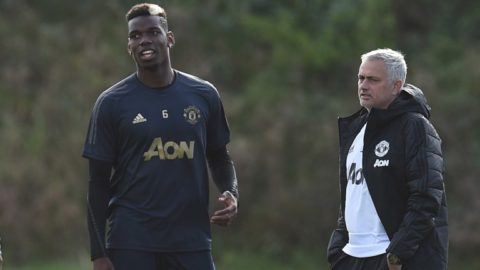 Manchester United's Portuguese manager Jose Mourinho (R) and Manchester United's French midfielder Paul Pogba (L) attend a training session at the Carrington Training complex in Manchester, north west England on October 22, 2018, ahead of their UEFA Champions League group H football match against Juventus on October 23. (Photo by Oli SCARFF / AFP)