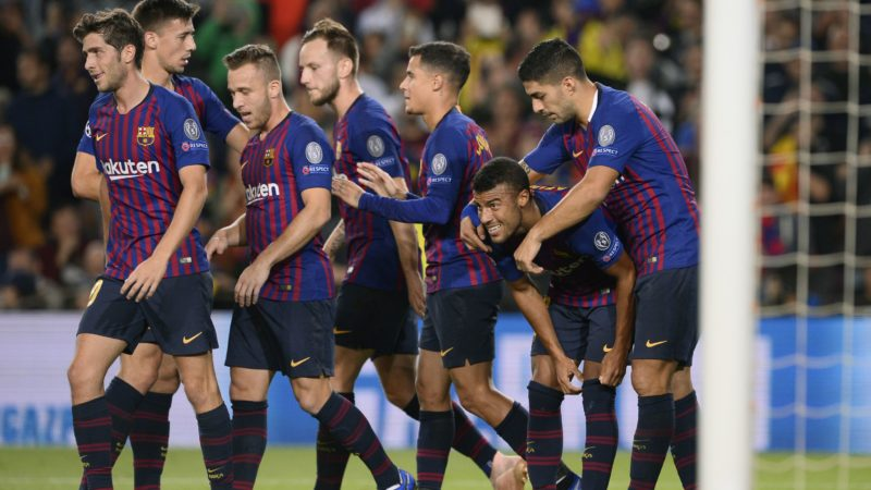 Barcelona's Brazilian midfielder Rafinha (2R) celebrates with teammates after scoring during the UEFA Champions League group B match Barcelona against Inter Milan at the Camp Nou stadium in Barcelona on October 24, 2018. (Photo by Josep LAGO / AFP)