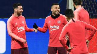 Barcelona's Argentinian forward Lionel Messi (L) jokes with Barcelona's Spanish defender Jordi Alba (C) during a training session on November 5, 2018 at San Siro stadium, on the eve of the UEFA Champions League group B football match Inter Milan vs Barcelone. (Photo by Miguel MEDINA / AFP)