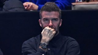 Former England football captain David Beckham watches as France's Pierre-Hugues Herbert and France's Nicolas Mahut play against US player Jack Sock and US player Mike Bryan in their men's doubles final match on day eight of the ATP World Tour Finals tennis tournament at the O2 Arena in London on November 18, 2018. (Photo by Glyn KIRK / AFP)