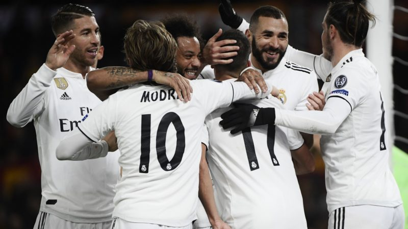 (From L) Real Madrid's Spanish defender Sergio Ramos, Real Madrid's Croatian midfielder Luka Modric, Real Madrid's Brazilian defender Marcelo, Real Madrid's Spanish midfielder Lucas Vazquez, Real Madrid's French forward Karim Benzema and Real Madrid's Welsh forward Gareth Bale celebrate after Vazquez scored 0-2 during the UEFA Champions League group G football match AS Rome vs Real Madrid on November 27, 2018 at the Olympic stadium in Rome. (Photo by Filippo MONTEFORTE / AFP)