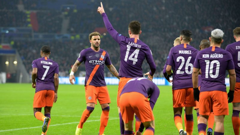 Manchester City's French defender Aymeric Laporte (C) celebrates with teammates after scoring a goal during the UEFA Champions League Group F football match between Olympique Lyonnais and Manchester City at the Parc Olympique Lyonnais stadium in Decines-Charpieu, central-eastern France, on November 27, 2018. (Photo by ROMAIN LAFABREGUE / AFP)
