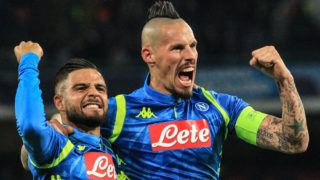 Napoli's Slovak midfielder Marek Hamsik (R) celebrates with Napoli's Italian forward Lorenzo Insigne after opening the scoring during the UEFA Champions League group C football match Napoli vs Red Star Belgrade on November 28, 2018 at the San Paolo stadium in Naples. (Photo by Carlo Hermann / AFP)