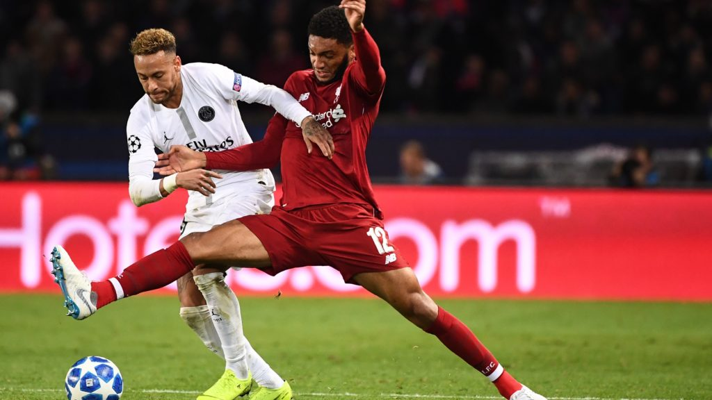 Paris Saint-Germain's Brazilian forward Neymar (L) vies for the ball with Liverpool's English defender Joe Gomez (R) during the UEFA Champions League Group C football match between Paris Saint-Germain (PSG) and Liverpool FC at the Parc des Princes stadium, in Paris, on November 28, 2018. (Photo by FRANCK FIFE / AFP)