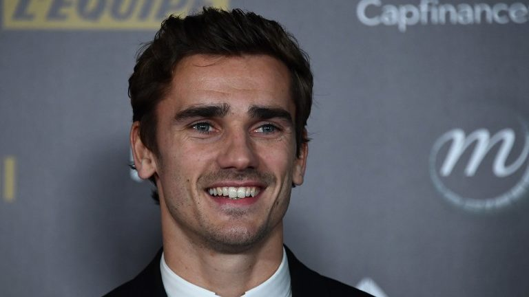 Atletico Madrid's French forward Antoine Griezmann poses upon arrival at the 2018 Ballon d'Or award ceremony at the Grand Palais in Paris on December 3, 2018. (Photo by Anne-Christine POUJOULAT / AFP)
