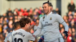 Real Madrid's Welsh forward Gareth Bale (R) is congratulated by teammate defender Alvaro Odriozola during the Spanish league football match between SD Huesca and Real Madrid CF at the El Alcoraz stadium on December 9, 2018. (Photo by ANDER GILLENEA / AFP)