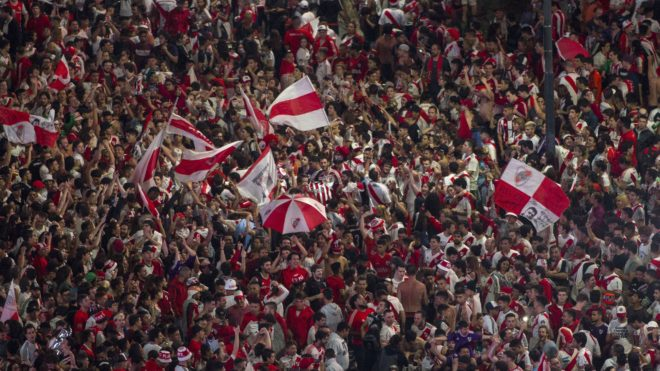 Fans of River Plate celebrate at the Plaza de la Republica, Buenos Aires, Argentina after the team won the all-Argentine Copa Libertadores final against Boca Juniors at the Santiago Bernabeu stadium in Madrid, Spain on December 9, 2018. (Photo by ALBERTO RAGGIO / AFP)