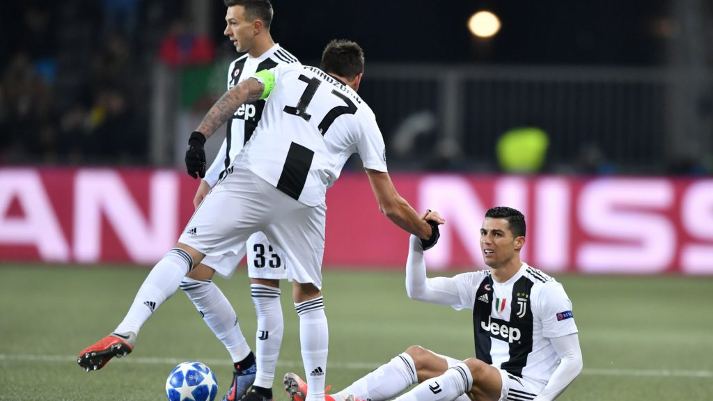 (From L) Juventus' Italian forward Federico Bernardeschi, Juventus' Croatian forward Mario Mandzukic and Juventus' Portuguese forward Cristiano Ronaldo are seen during the UEFA Champions League group H football match between Young Boys and Juventus at the Stade de Suisse stadium on December 12, 2018 in Bern. (Photo by Fabrice COFFRINI / AFP)