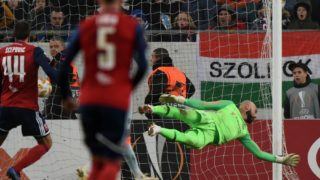 FC Chelsea's English goalkeeper Willy Caballero fails to stop a goal by Mol Vidi's French forward Loic Nego (unseen) during the UEFA Europa League Group L football match between MOL Vidi FC and Chelsea on December 13, 2018 in Budapest. (Photo by ATTILA KISBENEDEK / AFP)