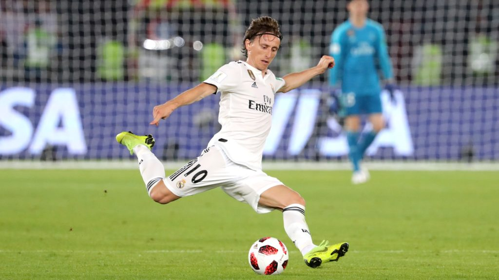 Real Madrid's Croatian midfielder Luka Modric passes the ball during the semi final football match of the FIFA Club World Cup 2018 tournament between Japan's Kashima Antlers and Spain's Real Madrid at the Zayed Sports City Stadium in Abu Dhabi, the capital of the United Arab Emirates, on December 19, 2018. (Photo by KARIM SAHIB / AFP)