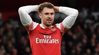Arsenal's Welsh midfielder Aaron Ramsey reacts during the English League Cup quarter-final football match between Arsenal and Tottenham Hotspur at the Emirates Stadium in London on December 19, 2018. (Photo by Ben STANSALL / AFP) / RESTRICTED TO EDITORIAL USE. No use with unauthorized audio, video, data, fixture lists, club/league logos or 'live' services. Online in-match use limited to 120 images. An additional 40 images may be used in extra time. No video emulation. Social media in-match use limited to 120 images. An additional 40 images may be used in extra time. No use in betting publications, games or single club/league/player publications. /