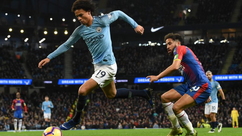 Manchester City's German midfielder Leroy Sane (L) beats Crystal Palace's English midfielder Andros Townsend (R) during the English Premier League football match between Manchester City and Crystal Palace at the Etihad Stadium in Manchester, north west England, on December 22, 2018. (Photo by Paul ELLIS / AFP) / RESTRICTED TO EDITORIAL USE. No use with unauthorized audio, video, data, fixture lists, club/league logos or 'live' services. Online in-match use limited to 120 images. An additional 40 images may be used in extra time. No video emulation. Social media in-match use limited to 120 images. An additional 40 images may be used in extra time. No use in betting publications, games or single club/league/player publications. /