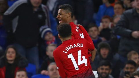 Manchester United's English striker Marcus Rashford celebrates with Manchester United's English midfielder Jesse Lingard after scoring the opening goal of the English Premier League football match between between Cardiff City and Manchester United at Cardiff City Stadium in Cardiff, south Wales on  December 22, 2018. (Photo by Geoff CADDICK / AFP) / RESTRICTED TO EDITORIAL USE. No use with unauthorized audio, video, data, fixture lists, club/league logos or 'live' services. Online in-match use limited to 120 images. An additional 40 images may be used in extra time. No video emulation. Social media in-match use limited to 120 images. An additional 40 images may be used in extra time. No use in betting publications, games or single club/league/player publications. /