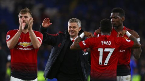 Manchester United's Norwegian caretaker manager Ole Gunnar Solskjaer (C) celebrates with his players on the pitch after the English Premier League football match between between Cardiff City and Manchester United at Cardiff City Stadium in Cardiff, south Wales on  December 22, 2018. - Manchester United won the game 5-1. (Photo by Geoff CADDICK / AFP) / RESTRICTED TO EDITORIAL USE. No use with unauthorized audio, video, data, fixture lists, club/league logos or 'live' services. Online in-match use limited to 120 images. An additional 40 images may be used in extra time. No video emulation. Social media in-match use limited to 120 images. An additional 40 images may be used in extra time. No use in betting publications, games or single club/league/player publications. /