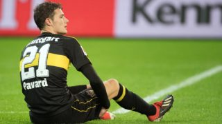 09 December 2018, North Rhine-Westphalia, Mönchengladbach: Soccer: Bundesliga, Borussia Mönchengladbach - VfB Stuttgart, 14th matchday in Borussia Park stadium. Stuttgart's Benjamin Pavard sits on the lawn. Photo: Federico Gambarini/dpa - IMPORTANT NOTE: In accordance with the requirements of the DFL Deutsche Fußball Liga or the DFB Deutscher Fußball-Bund, it is prohibited to use or have used photographs taken in the stadium and/or the match in the form of sequence images and/or video-like photo sequences.
