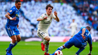 MADRID, SPAIN - DECEMBER 06:  Alvaro Odriozola of Real Madrid evades Jilmar Torres of UD Melilla (3) during the Copa del Rey fourth round match between Real Madrid and Melilla at Estadio Bernabeu on December 6, 2018 in Madrid, Spain.  (Photo by Gonzalo Arroyo Moreno/Getty Images)