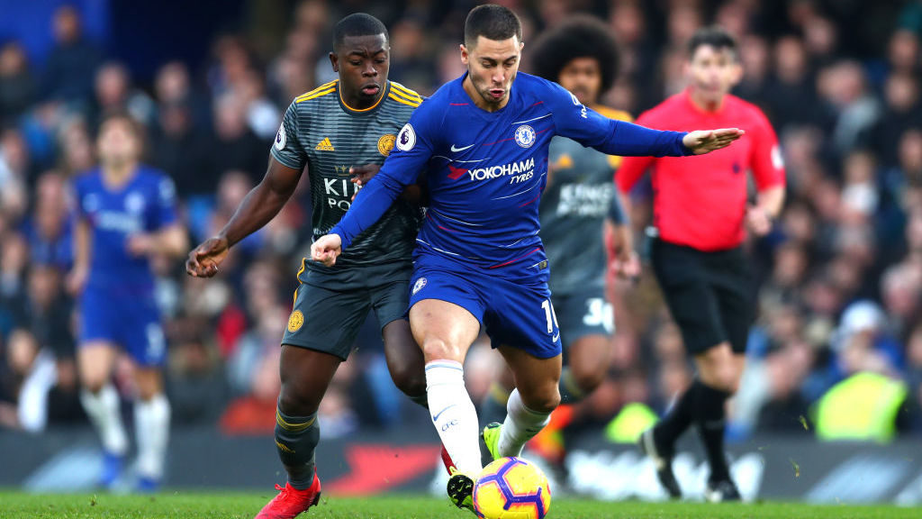 LONDON, ENGLAND - DECEMBER 22:  Eden Hazard of Chelsea battles for possession with Nampalys Mendy of Leicester City during the Premier League match between Chelsea FC and Leicester City at Stamford Bridge on December 22, 2018 in London, United Kingdom.  (Photo by Clive Rose/Getty Images)