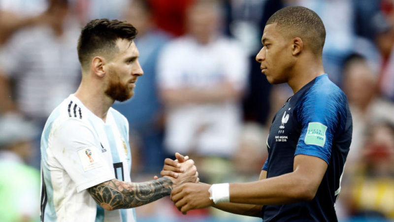 Lionel Messi (l) of Argentina and Kylian Mbappe of France embrace after the 2018 FIFA World Cup Russia Round of 16 match between France and Argentina at Kazan Arena on June 30, 2018 in Kazan, Russia.  (Photo by Mehdi Taamallah/NurPhoto via Getty Images)
