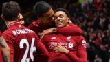 Liverpool's English defender Trent Alexander-Arnold (R) celebrates with Liverpool's Dutch defender Virgil van Dijk (C) after scoring their second goal during the English Premier League football match between Watford and Liverpool at Vicarage Road Stadium in Watford, north of London on November 24, 2018. (Photo by OLLY GREENWOOD / AFP) / RESTRICTED TO EDITORIAL USE. No use with unauthorized audio, video, data, fixture lists, club/league logos or 'live' services. Online in-match use limited to 120 images. An additional 40 images may be used in extra time. No video emulation. Social media in-match use limited to 120 images. An additional 40 images may be used in extra time. No use in betting publications, games or single club/league/player publications. /