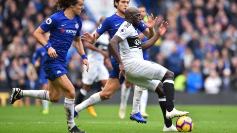 Fulham's French striker Aboubakar Kamara (R) vies with Chelsea's Brazilian defender David Luiz (L) and Chelsea's Spanish defender Marcos Alonso (C) during the English Premier League football match between Chelsea and Fulham at Stamford Bridge in London on December 2, 2018. (Photo by Glyn KIRK / AFP) / RESTRICTED TO EDITORIAL USE. No use with unauthorized audio, video, data, fixture lists, club/league logos or 'live' services. Online in-match use limited to 120 images. An additional 40 images may be used in extra time. No video emulation. Social media in-match use limited to 120 images. An additional 40 images may be used in extra time. No use in betting publications, games or single club/league/player publications. /