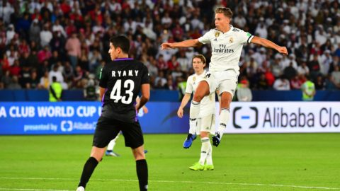 Real Madrid's Spanish midfielder Marcos Llorente (R) kicks and scores during the FIFA Club World Cup final football match Spain's Real Madrid vs Abu Dhabi's Al Ain at the Zayed Sports City Stadium in Abu Dhabi, the capital of the United Arab Emirates, on December 22, 2018. (Photo by Giuseppe CACACE / AFP)