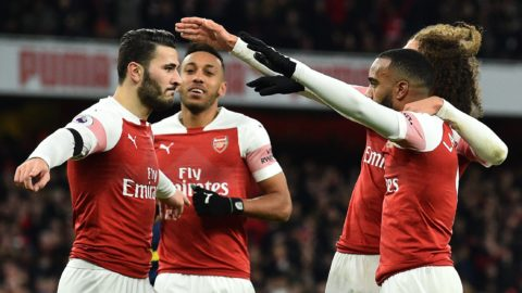 Arsenal's French striker Alexandre Lacazette (R) celebrates scoring his team's second goal during the English Premier League football match between Arsenal and Fulham at the Emirates Stadium in London on January 1, 2019. (Photo by Glyn KIRK / AFP) / RESTRICTED TO EDITORIAL USE. No use with unauthorized audio, video, data, fixture lists, club/league logos or 'live' services. Online in-match use limited to 120 images. An additional 40 images may be used in extra time. No video emulation. Social media in-match use limited to 120 images. An additional 40 images may be used in extra time. No use in betting publications, games or single club/league/player publications. /