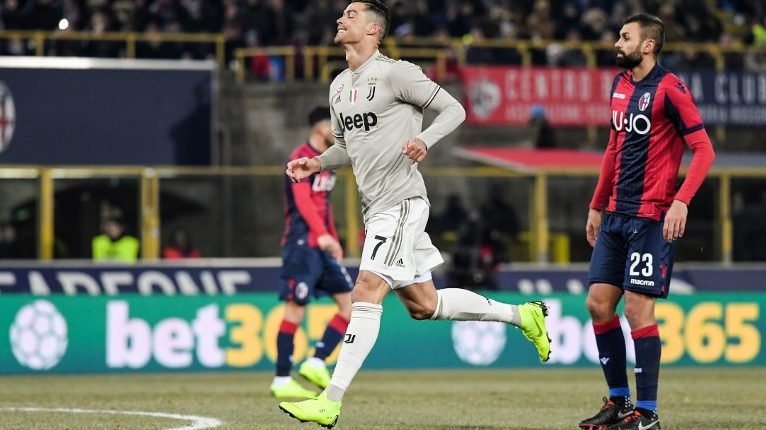 Juventus' Portuguese forward Cristiano Ronaldo (C) reacts during the Italian Tim Cup round of sixteen football match Bologna vs Juventus on January 12, 2019 at the Renato-Dall'Ara stadium in Bologna. (Photo by Tiziana FABI / AFP)
