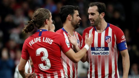 MADRID, SPAIN - OCTOBER 27: Filipe Luis (L) of Atletico Madrid celebrates with Diego Godin (R) and Diego Costa (C) after scoring a goal during the La Liga match between Atletico Madrid and Real Sociedad at Wanda Metropolitano on October 27, 2018 in Madrid, Spain.  Burak Akbulut / Anadolu Agency