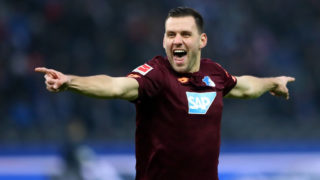 BERLIN, GERMANY - NOVEMBER 24:  Adam Szalai of 1899 Hoffenheim celebrates as teammate Kerem Demirbay scores their team's first goal during the Bundesliga match between Hertha BSC and TSG 1899 Hoffenheim at Olympiastadion on November 24, 2018 in Berlin, Germany.  (Photo by Martin Rose/Bongarts/Getty Images)