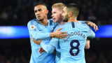 MANCHESTER, ENGLAND - JANUARY 14:  Kevin De Bruyne of Manchester City celebrates with teammates Danilo and Ilkay Gundogan of Manchester City as Conor Coady of Wolverhampton Wanderers (not pictured) scores their team's third goal for an own goal during the Premier League match between Manchester City and Wolverhampton Wanderers at Etihad Stadium on January 12, 2019 in Manchester, United Kingdom.  (Photo by Clive Mason/Getty Images)