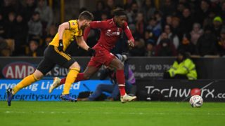 Wolverhampton Wanderers' Irish defender Matt Doherty (L) vies with Liverpool's Belgium striker Divock Origi during the English FA Cup third round football match between Wolverhampton Wanderers and Liverpool at the Molineux stadium in Wolverhampton, central England on January 7, 2019. (Photo by Paul ELLIS / AFP) / RESTRICTED TO EDITORIAL USE. No use with unauthorized audio, video, data, fixture lists, club/league logos or 'live' services. Online in-match use limited to 120 images. An additional 40 images may be used in extra time. No video emulation. Social media in-match use limited to 120 images. An additional 40 images may be used in extra time. No use in betting publications, games or single club/league/player publications. /