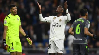 Real Madrid's Brazilian forward Vinicius Junior (C) protests during the Spanish League football match between Real Madrid CF and Real Sociedad at the Santiago Bernabeu stadium in Madrid on January 6, 2019. (Photo by GABRIEL BOUYS / AFP)