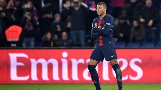 Paris Saint-Germain's French forward Kylian MBappe celebrates after scoring a goal during the French L1 football match between Paris Saint-Germain (PSG) and Nantes (FCN) at the Parc des Princes stadium in Paris on December 23, 2018. (Photo by FRANCK FIFE / AFP)