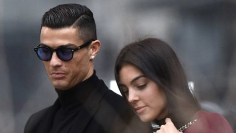 Juventus' forward and former Real Madrid player Cristiano Ronaldo leaves with his Spanish girlfriend Georgina Rodriguez after attending a court hearing for tax evasion in Madrid on January 22, 2019. - Ronaldo is expected to be given a hefty fine after Spanish tax authorities and the player's advisors made a deal to settle claims he hid income generated from image rights when he played for Real Madrid. (Photo by OSCAR DEL POZO / AFP)