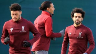 Liverpool's English midfielder Alex Oxlade-Chamberlain (L), Liverpool's Dutch defender Virgil van Dijk (C) and Liverpool's Egyptian midfielder Mohamed Salah attends a team training session at Melwood in Liverpool, north west England on February 18, 2019, on the eve of their Champions League round of 16, first leg football match against Bayern Munich. (Photo by Lindsey PARNABY / AFP)