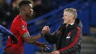 Manchester United's  Norwegian caretaker manager Ole Gunnar Solskjaer (R) celebrates their victory with Manchester United's French midfielder Paul Pogba (L) on the pitch after the English FA Cup fifth round football match between Chelsea and Manchester United at Stamford Bridge in London on February 18, 2019. - Manchester United won the game 2-0. (Photo by Ian KINGTON / AFP) / RESTRICTED TO EDITORIAL USE. No use with unauthorized audio, video, data, fixture lists, club/league logos or 'live' services. Online in-match use limited to 120 images. An additional 40 images may be used in extra time. No video emulation. Social media in-match use limited to 120 images. An additional 40 images may be used in extra time. No use in betting publications, games or single club/league/player publications. /