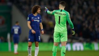 Chelsea's Spanish goalkeeper Kepa Arrizabalaga gestures toward the bench after his number came up for substitution and didn't leave the pitch during the English League Cup final football match between Manchester City and Chelsea at Wembley stadium in north London on February 24, 2019. (Photo by Adrian DENNIS / AFP) / RESTRICTED TO EDITORIAL USE. No use with unauthorized audio, video, data, fixture lists, club/league logos or 'live' services. Online in-match use limited to 75 images, no video emulation. No use in betting, games or single club/league/player publications. /