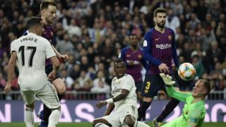 Real Madrid's Brazilian forward Vinicius Junior (3L) vies with Barcelona's German goalkeeper Marc-Andre Ter Stegen during the Spanish Copa del Rey (King's Cup) semi-final second leg football match between Real Madrid and Barcelona at the Santiago Bernabeu stadium in Madrid on February 27, 2019. (Photo by JAVIER SORIANO / AFP)