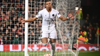 Paris Saint-Germain's French striker Kylian Mbappe celebrates scoring his team's second goal during the first leg of the UEFA Champions League round of 16 football match between Manchester United and Paris Saint-Germain (PSG) at Old Trafford in Manchester, north-west England on February 12, 2019. (Photo by FRANCK FIFE / AFP)