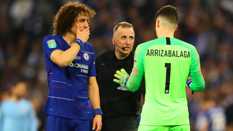 LONDON, ENGLAND - FEBRUARY 24: Kepa Arrizabalaga of Chelsea chats with referee Jonathan Moss as he is called to be substituted during the Carabao Cup Final between Chelsea and Manchester City at Wembley Stadium on February 24, 2019 in London, England. (Photo by Chris Brunskill/Fantasista/Getty Images)