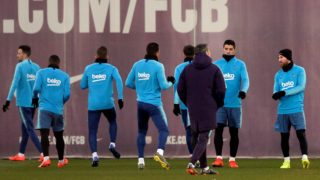 Barcelona's Spanish coach Ernesto Valverde (3R) talks with Barcelona's Uruguayan forward Luis Suarez (2R) and Barcelona's Argentinian forward Lionel Messi (R) during a training session at the Joan Gamper Sports Center in Sant Joan Despi on February 5, 2019. (Photo by Josep LAGO / AFP)