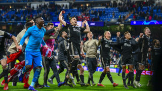 Ajax's players celebrate at the end of the UEFA Champions League round of 16 second leg football match between Real Madrid CF and Ajax at the Santiago Bernabeu stadium in Madrid on March 5, 2019. (Photo by GABRIEL BOUYS / AFP)