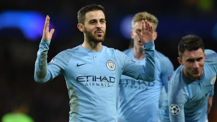 Manchester City's Portuguese midfielder Bernardo Silva celebrates after scoring their fifth goal during the UEFA Champions League round of 16 second leg football match between Manchester City and Schalke 04 at the Etihad Stadium in Manchester, north west England, on March 12, 2019. (Photo by Oli SCARFF / AFP)